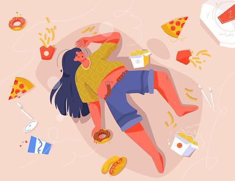 Sad fat woman eating fast food, lying on floor