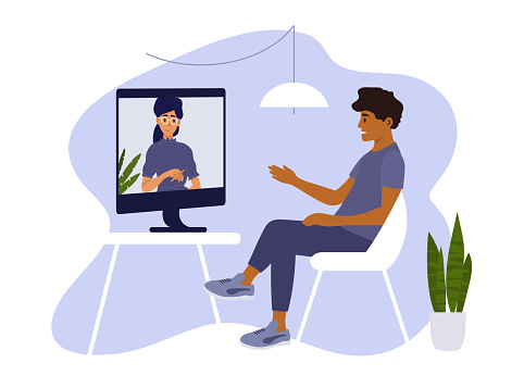 Sad man making video call with female psychologist by computer