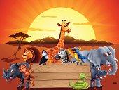 Safari animals and a sunset behind a wood sign