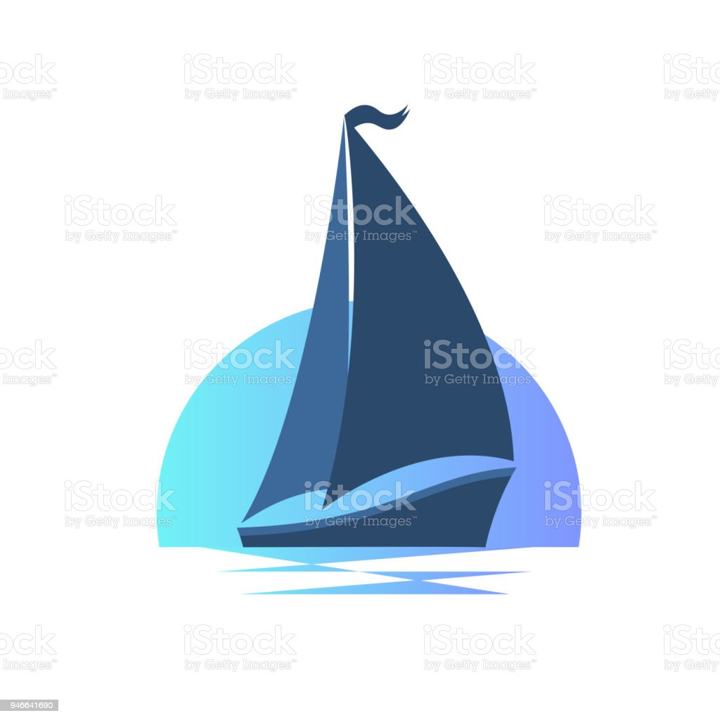 Sailing boat on the waves at sunset.
