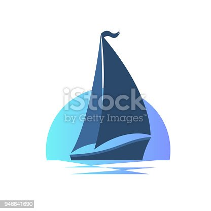 istock Sailing boat on the waves at sunset. 946641690