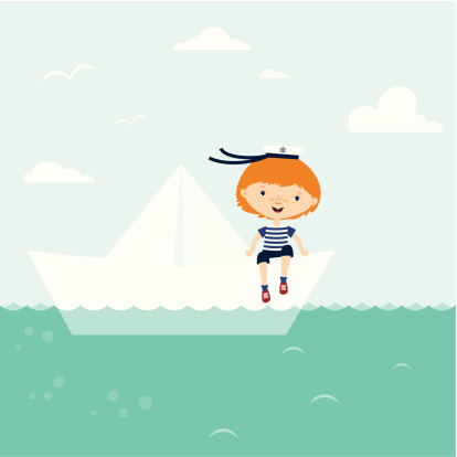 Sailor boy with paper boat