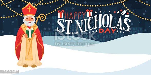 istock Saint Nicholas holding gift. 1283741477