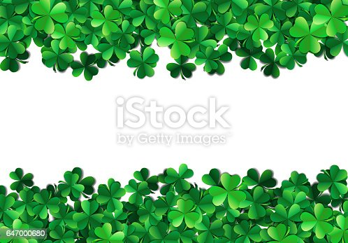 Saint Patricks day background with sprayed green clover leaves o