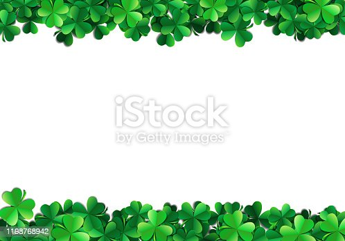 istock Saint Patricks day background with sprayed green clover leaves or shamrocks 1198768942