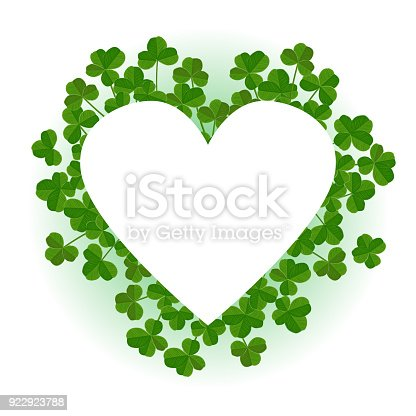 istock Saint Patricks Day vector background, heart shape frame with realistic shamrock leaves 922923788