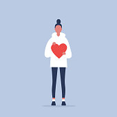 Saint Valentines Day. Young female character holding a red heart. Relationships. Love. Romance. Emotions. Flat editable vector illustration, clip art