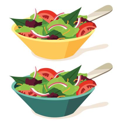 Crisp fresh green salad in 2 different color bowls.