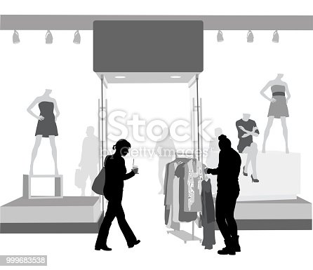 Women in front of a clothing store with mannequins in the display window