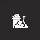 istock sand bucket icon. Filled sand bucket icon for website design and mobile, app development. sand bucket icon from filled summer collection isolated on black background. 1169165764