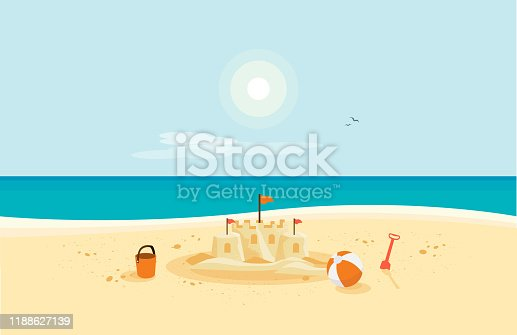 istock Sand Castle on Sandy Beach with Blue Sea Ocean and Clear Summer Sunny Sky 1188627139