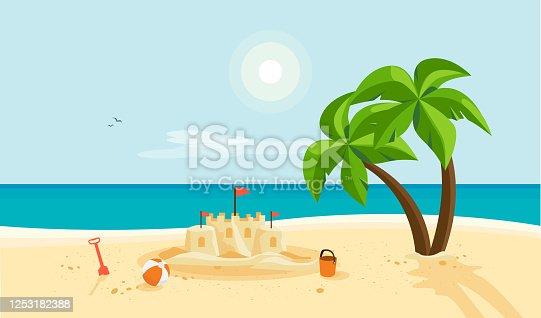 istock Sand Castle on Sandy Beach with Blue Sea Ocean and Clear Summer Sunny Sky 1253182388