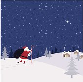 Santa Claus carrying the magic sack with gifts toward houses