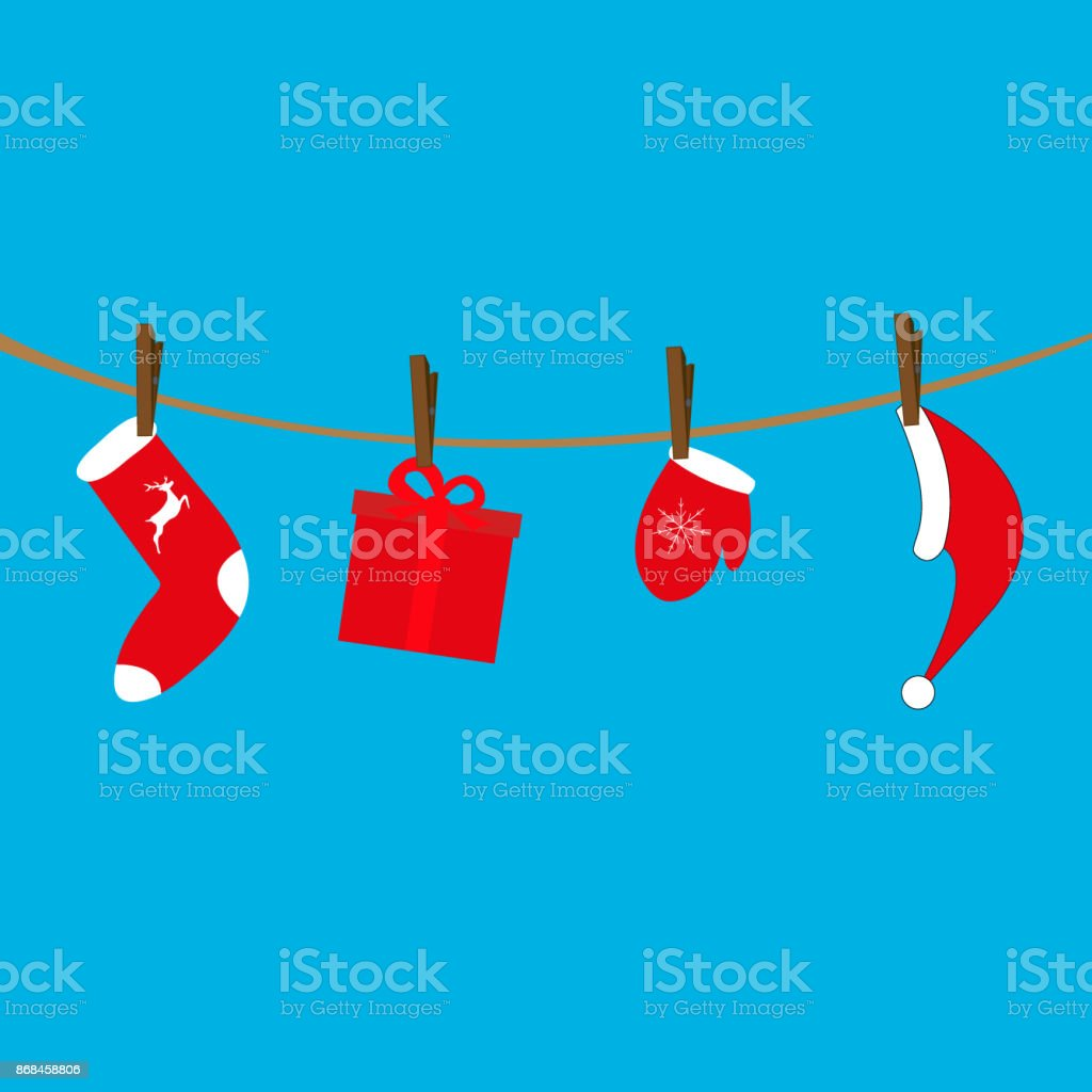 Santa Claus clothes hanging on a rope vector art illustration