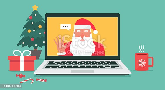Santa Claus hand greeting via video calling on the laptop