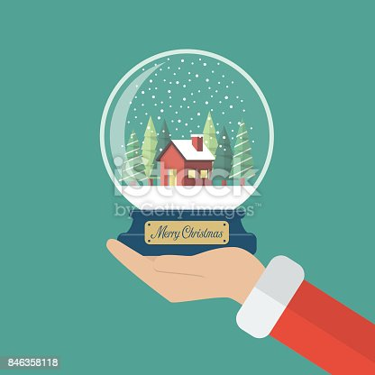 istock Santa claus hand holding christmas glass ball 846358118