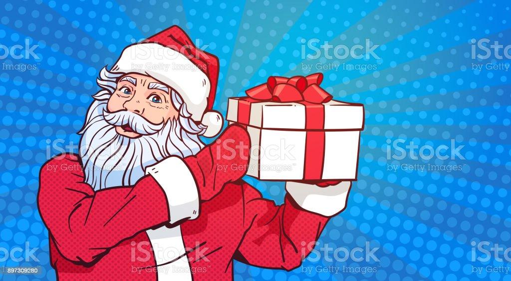 Comic Frohe Weihnachten.Santa Claus Halten Geschenkbox über Pop Art Comic Hintergrund Frohe