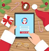 Santa Claus is log in to his digital account with password