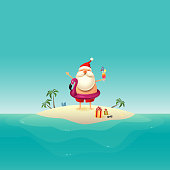 Santa Claus on sandy island at ocean with inflatable flamingo float
