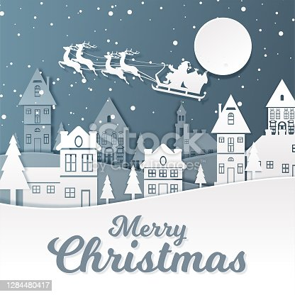 istock Santa Claus riding his reindeer sleigh flying over town. Christmas Background 1284480417