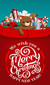 Santa Claus red sack full of present boxes. Lettering gift card.