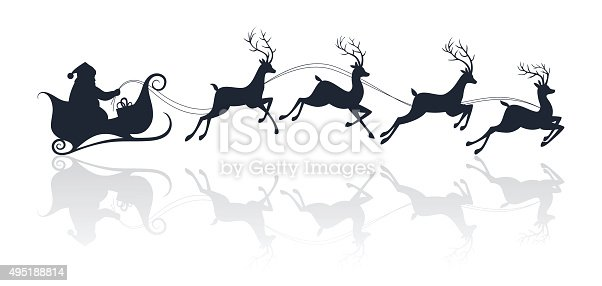 istock Santa Claus silhouette riding a sleigh with deers 495188814