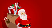 Santa Claus carrying sack full of gifts and candys