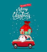 Merry christmas stylized typography. Vintage red car with santa claus and gift boxes.