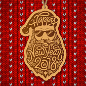Santa Claus with glasses and big beard with the typography Happy New Year 2018 on red knitted background. Wooden Christmas decoration. Vector illustration.