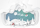 Santa claus with urban countryside on snow and winter season background.For merry christmas and happy new year paper art style.Vector illustration.