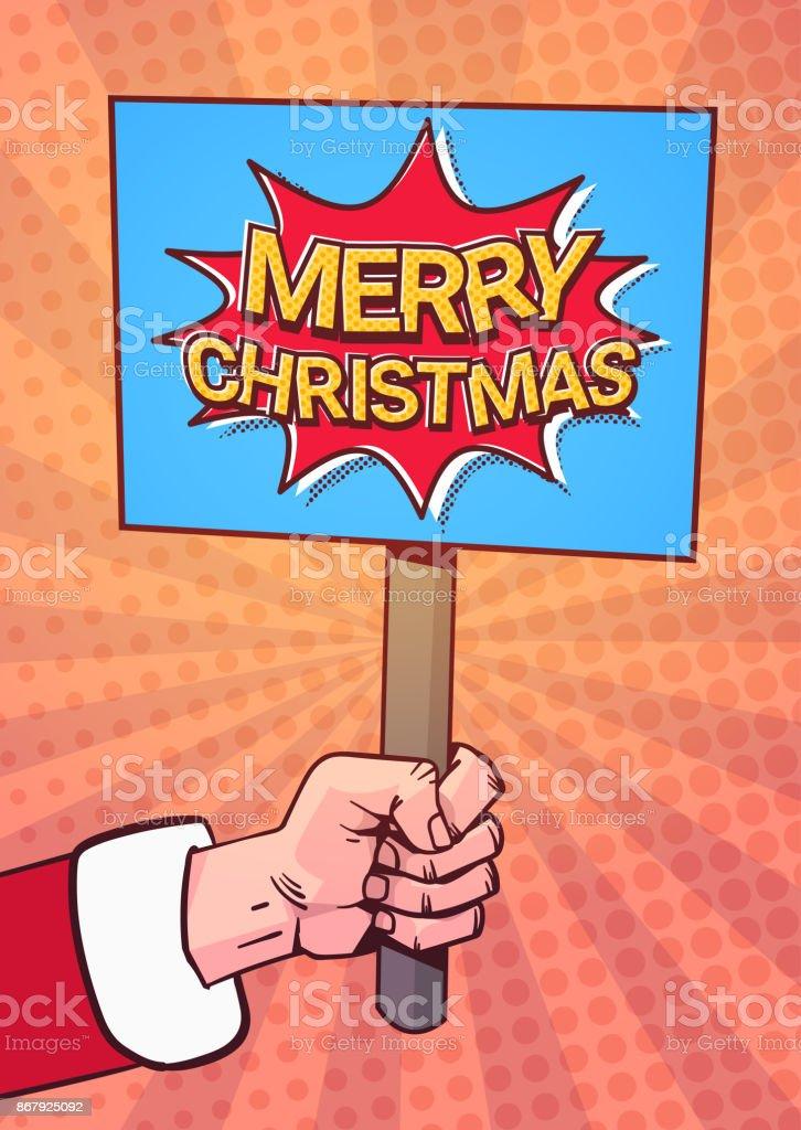 Comic Frohe Weihnachten.Santa Hand Halten Frohe Weihnachten Banner Pop Art Comic Hintergrund