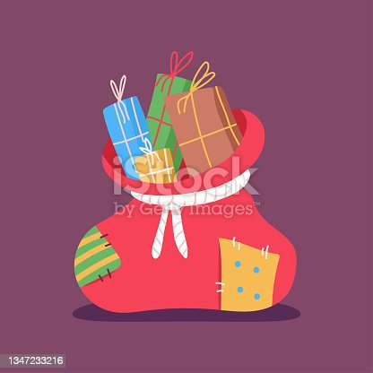 istock Santa sack with gift boxes vector cartoon illustration isolated on background. 1347233216