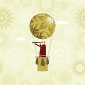 Christmas card with Santa flying by hot air balloon to share out sweets and gifts amongst the children of the world.