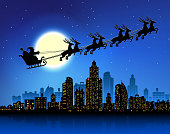 Santa's sleigh over urban skyline horizontal composition