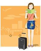 "A tourist reading her ""Savvy Traveler"" book."