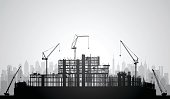 Scaffolding silhouette. Buildings and cranes are complete.