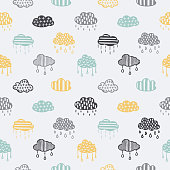 Scandinavian style hand drawn clouds seamless pattern. Monochrome nursery decorative elements set. Minimalistic cute drawings for prints, stickers, wrap paper. Vector vintage illustration.