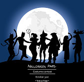 A vector silhouette illustration of young adults partying wearing costumes on Halloween in front of a full moon.