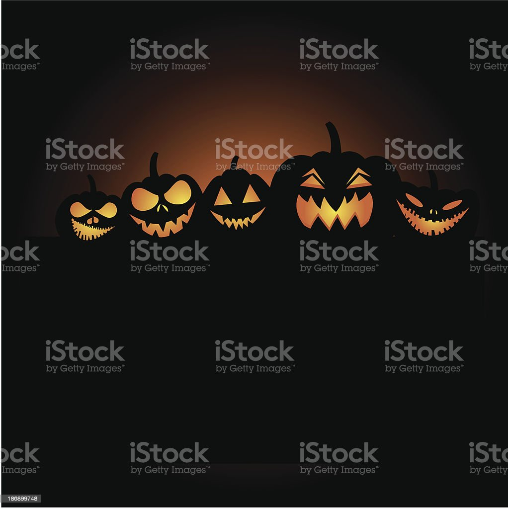Scary silhouetted pumpkins royalty-free stock vector art