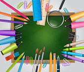 School background with lots of study supplies - a green chalkboard with a wooden frame, realistic pencils, spyglass, brushes, markers, rulers and other elements for education. Vector illustration.