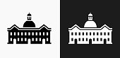 School Building Icon on Black and White Vector Backgrounds. This vector illustration includes two variations of the icon one in black on a light background on the left and another version in white on a dark background positioned on the right. The vector icon is simple yet elegant and can be used in a variety of ways including website or mobile application icon. This royalty free image is 100% vector based and all design elements can be scaled to any size.