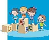 School kids with alphabet blocks