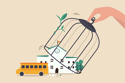 School reopen and keep social distancing after COVID-19 lockdown to prevent Coronavirus spreading in children concept, hand open bird cage over school to let school bus to go to pick up students.