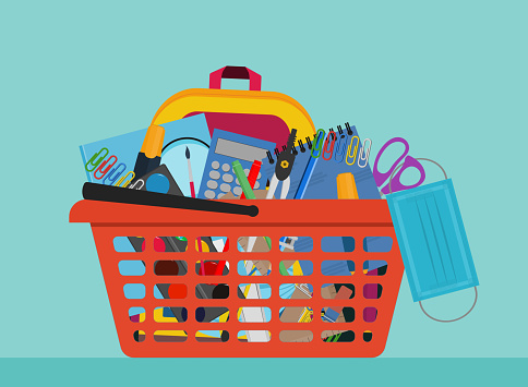 School Supplies In orange shopping basket with protective medical mask. COVID-19 coronavirus education concept