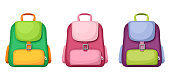 Vector set of three colorful schoolbags isolated on a white background.