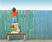 Schoolboy on pile of books looking over fence