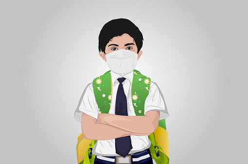 Schoolboy wearing protective face mask to protect from virus