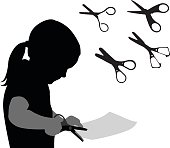A vector silhouette illustration of a young girl cutting a piece of paper using a pair of scissors.  Four more pairs of scissors are also in the image.