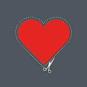 scissors cuts out a heart
