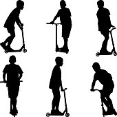 boy going with scooter silhouettes